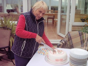 Judith cuts our 3rd cake of the year!